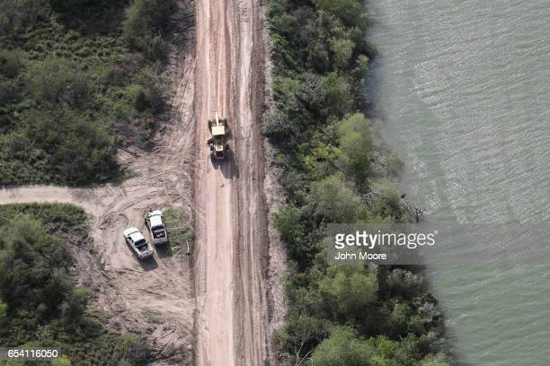 A road crew improves a road along the USMexico border on March 16 2017 in Hidalgo Texas There has been great speculation on exactly where a border...
