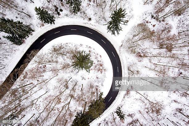 Road curve wintery forest aerial view