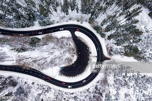 Road curve wintery forest aerial view snow