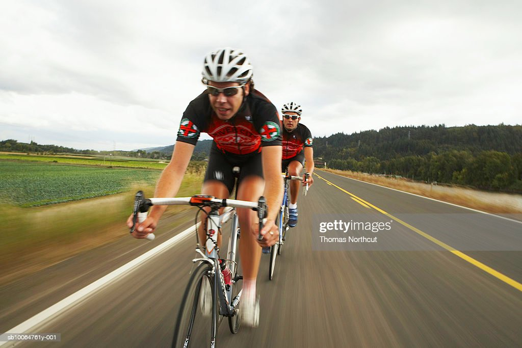 Road cyclists in action on country road : Stock Photo