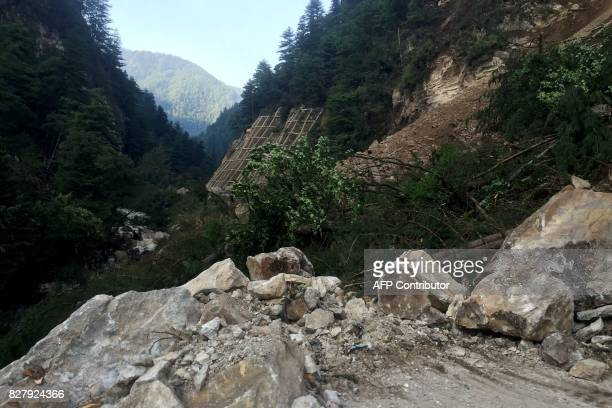 A road damaged during an earthquake is seen in Jiuzhaigou in China's southwestern Sichuan province on August 9 2017 At least 12 people were killed...
