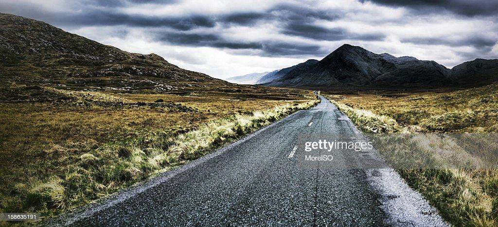 Road heading the Foggy Mountains : Stock Photo