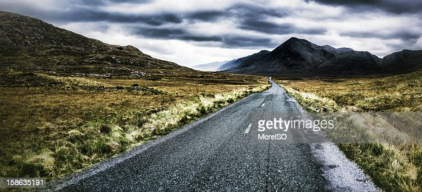 Road heading the Foggy Mountains : Stock Photo