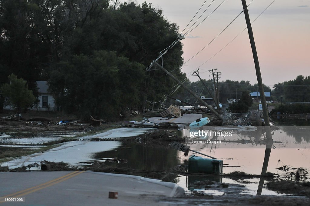 A road impassable to vehicles is shown covered in debris from flood waters September 17, 2013 near Evans, Colorado. Even as flooding subsides, many in the hardest hit areas of the state remain stranded by washed out roads and rushing creeks and without water and power.