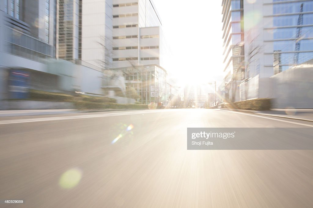 Road in city with sunlight : Stock Photo