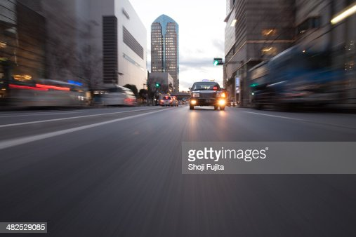 Road in city with taxy
