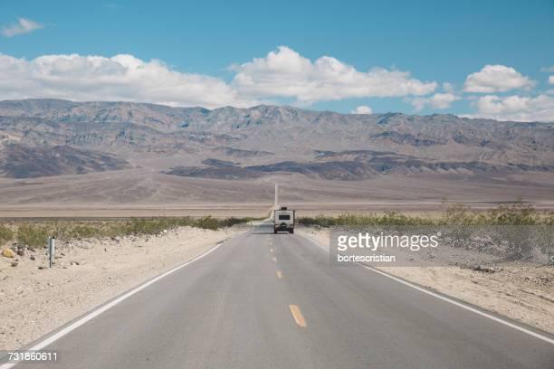 Road In Desert Against Sky
