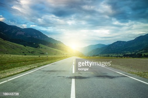 road in summer mountains to the sunset : Stock Photo