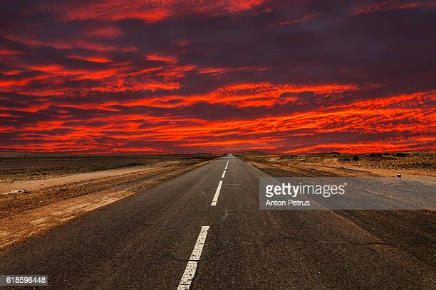 Road in the desert at sunset