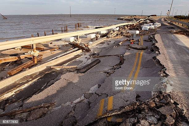 A road is collapsed following Hurricane Ike September 15 2008 in Galveston Texas Although search and rescue efforts continue on the island city...