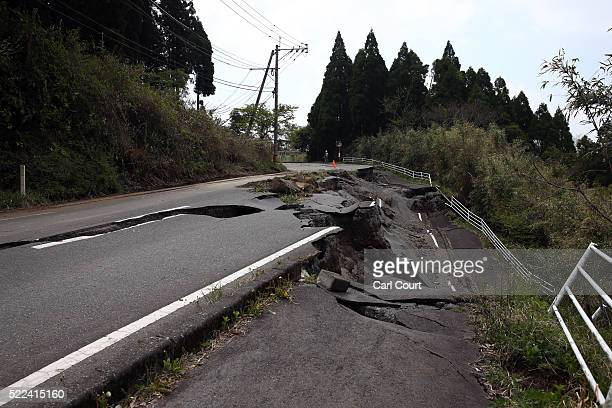 A road is partially destroyed by an earthquake on April 19 2016 in Minamiaso near Kumamoto Japan As of April 19 45 people were confirmed dead after...