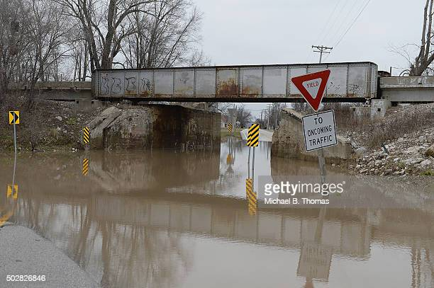 A road is seen completely submerged on December 29 2015 in West Alton Missouri Local authorities have called for a voluntary evacuation of the town...