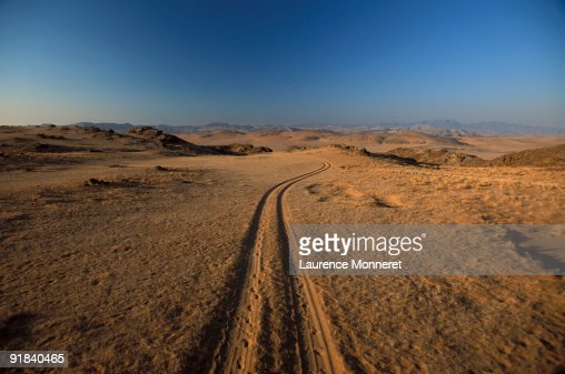 Road leading desert : Stock Photo