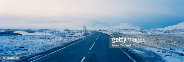 Road leading through winter landscape in Scotland