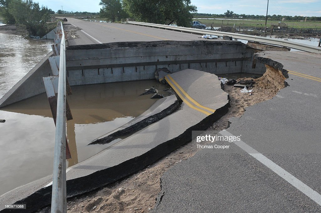 A road made impassable by flood waters is shown September 17, 2013 near Evans, Colorado. Even as flooding subsides, many in the hardest hit areas of the state remain stranded by washed out roads and rushing creeks and without water and power.