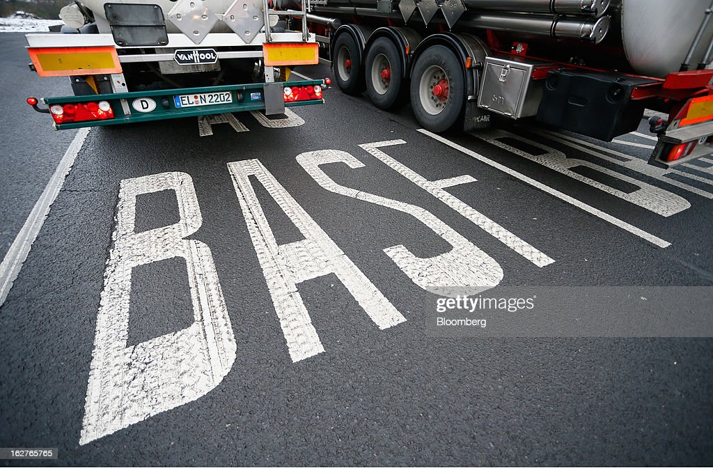 A road marking reading 'BASF' is seen near a parking bay at the BASF SE warehouse in Ludwigshafen, Germany, on Tuesday, Feb. 26, 2013. BASF SE forecast growth in earnings and sales this year after demand for plastics used to lighten cars and higher oil production buoyed quarterly earnings. Photographer: Ralph Orlowski/Bloomberg via Getty Images