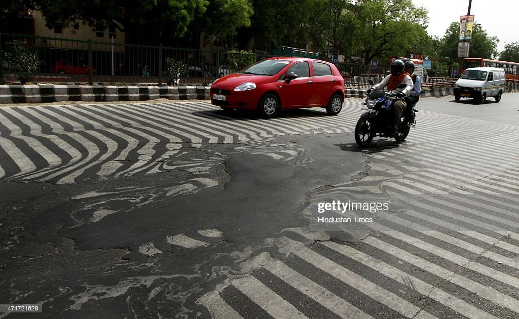 A road melt near Safdarjung Hospital after the Temperature rise to 45 degree Celsius during a hot weather as Delhi/NCR experienced yet another...
