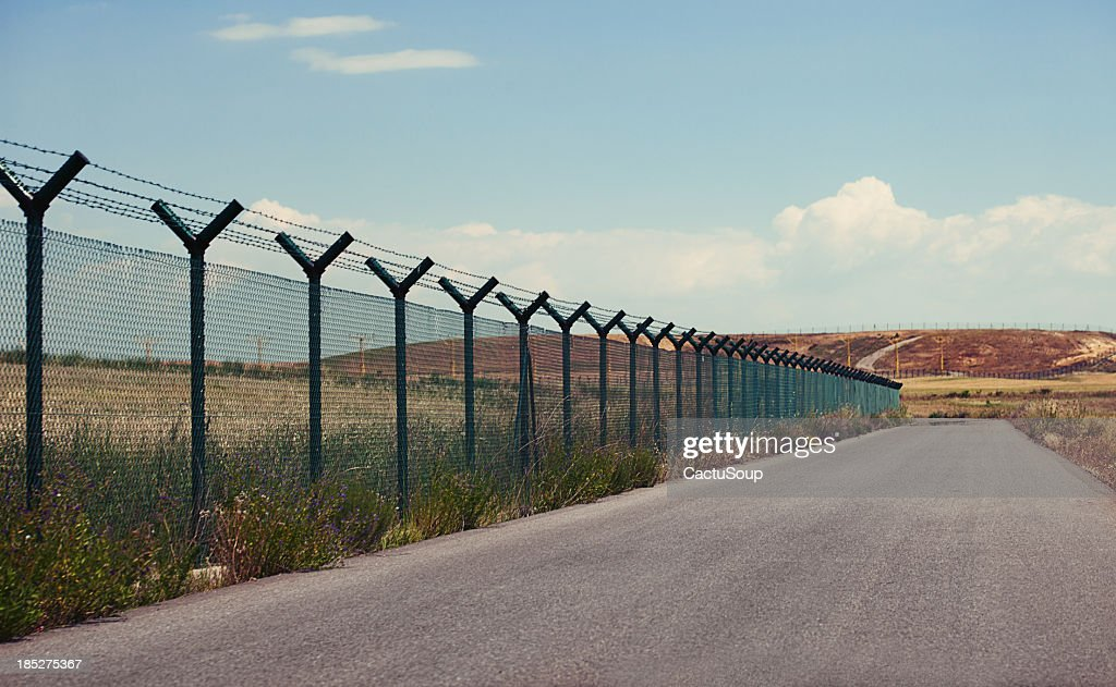 Road next to a fence