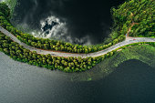 Road on a narrow piece of land between two lakes seen from the air at Punkaharju ridge Finland