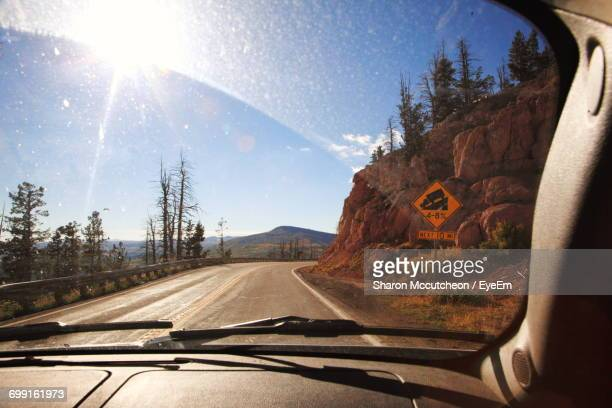 Road On Sunny Day Seen Through Car Windshield At Cedar Breaks National Monument