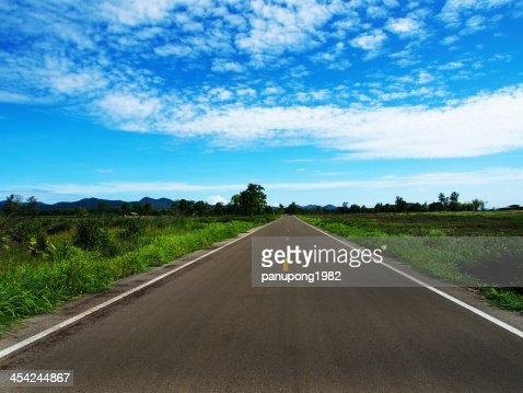 road on the background of clouds : Stock Photo