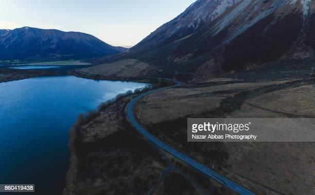 Road Passing by Lake Pearson (Moana Rua) High Country, New Zealand.