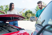 Angry stressed woman having a quarrel with one man after car crash