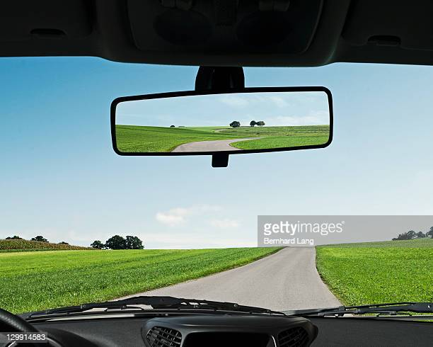Road reflected in rear view mirror, close-up