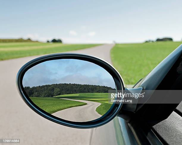 Road reflected in side view mirror, close-up
