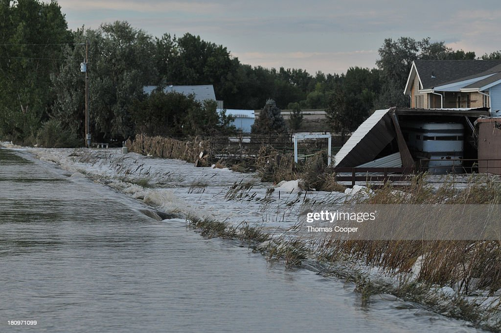 A road remains submerged by flood waters September 17, 2013 near Evans, Colorado. Even as flooding subsides, many in the hardest hit areas of the state remain stranded by washed out roads and rushing creeks and without water and power.