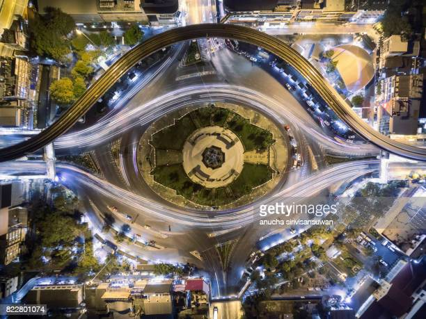 road roundabout large and electric train beautiful at night , Bird Eye View , victory monument , bangkok , thailand .