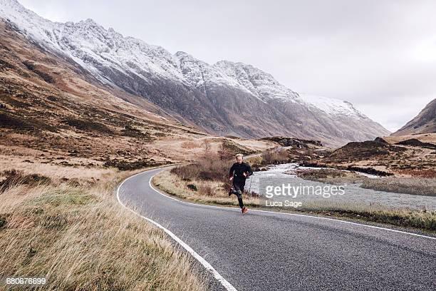 Road running in Scottish highlands near Glencoe