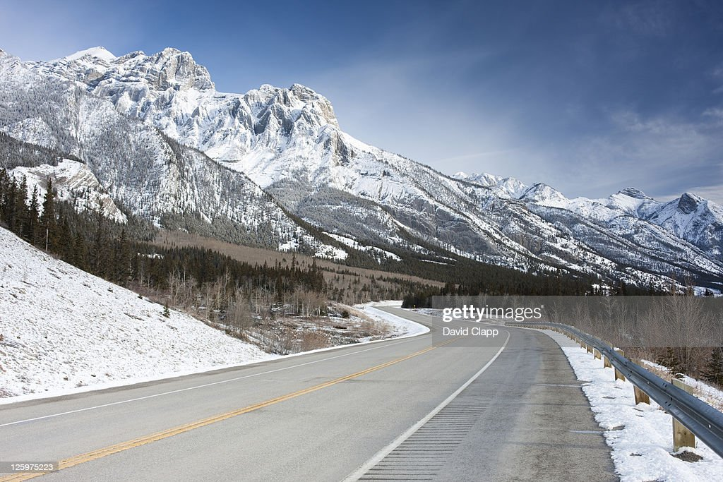 Road side view of Mount Abraham and its jagged snow covered slopes at Abraham Lake, Canadian Rockies, Alberta, Canada : Stock Photo