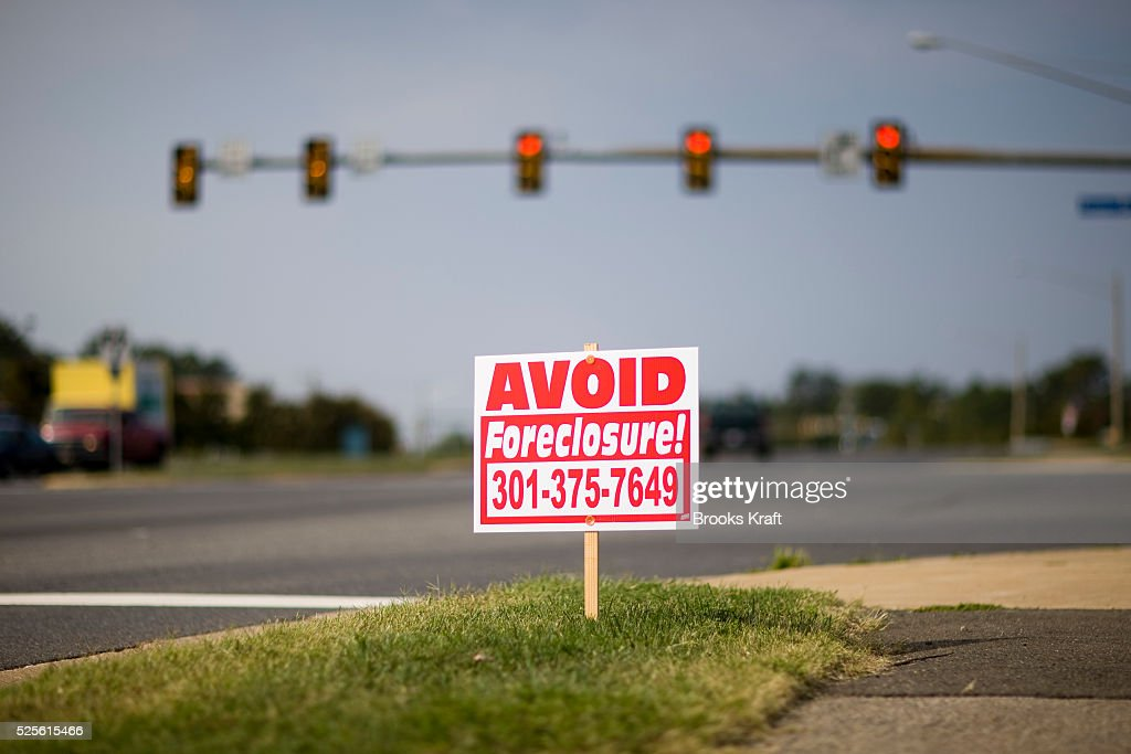 A road sign advertising help preventing foreclosure outside Woodbridge Traditionally a Republican county locals say the atmosphere of Prince William...