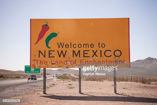 Road sign and highway, New Mexico State Line, USA
