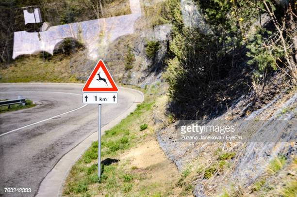 Road Sign By Mountain