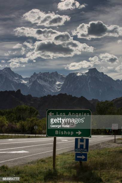 A road sign for Highway 395 is viewed with Mt Whitney in the background on April 6 in Lone Pine California Owens Valley is an arid valley in eastern...