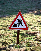 Road sign in field