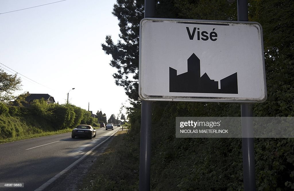 A road sign indicates the entrance to the Belgian town of Vise on April 19 2014 A couple and a young boy were shot dead in an overnight attack near...