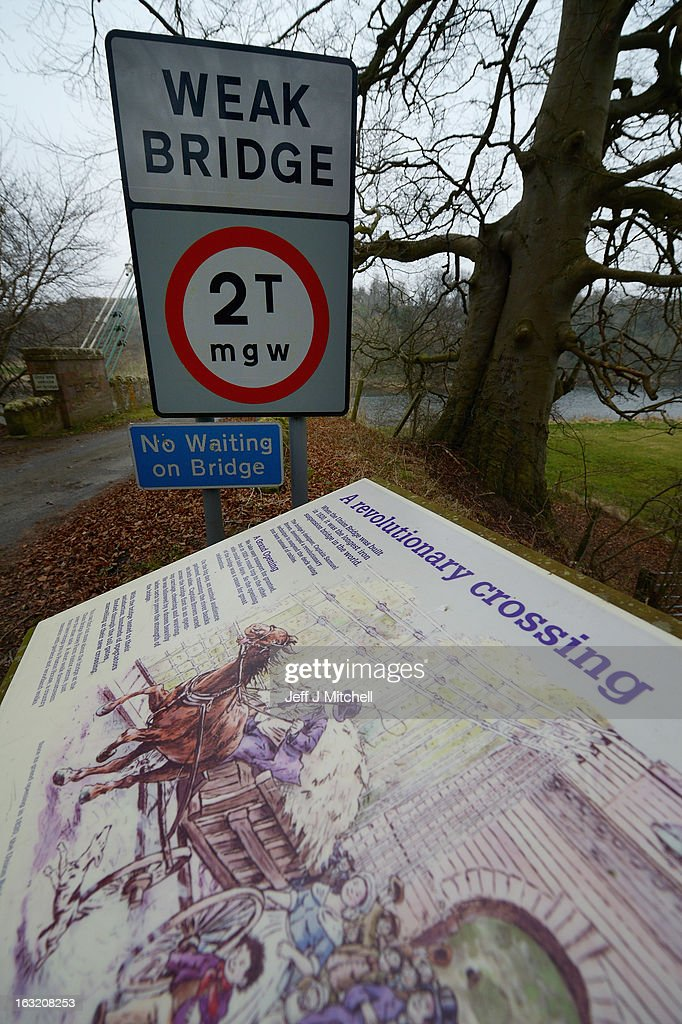 A road sign is displayed next to the Union Bridge on the River Tweed on March 6, 2013 in Berwick Upon Tweed, England. The bridge was built in 1820 and is Europe's oldest surviving iron chain suspension bridge. The bridge which connects the Scottish village of Fishwick to Horncliffe on the English bank is now facing closure with both Scottish Borders Council and Northumberland, citing a £4.7million repair bill for the structure.