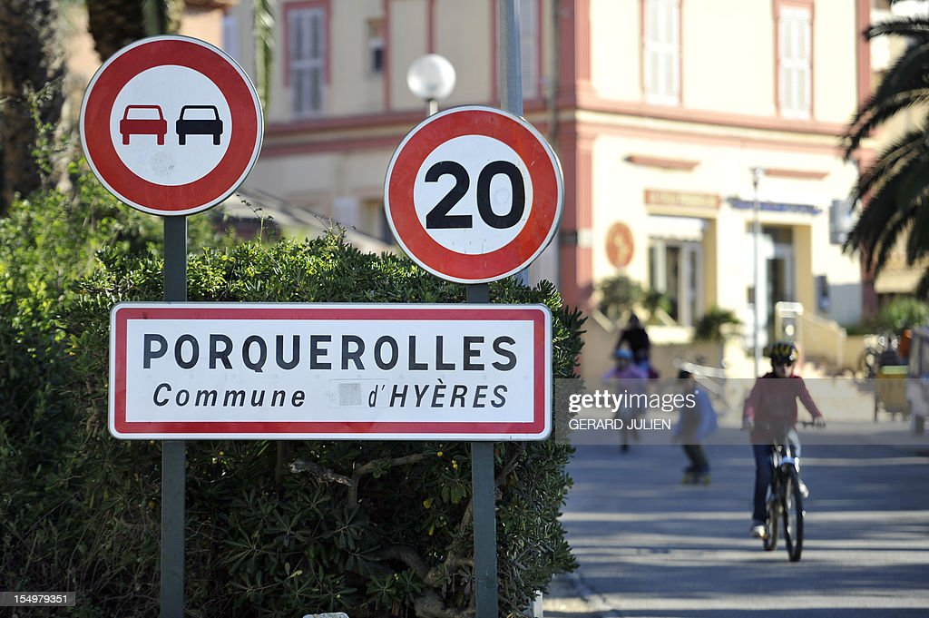 A road sign is pictured on October 29, 2012 on the Porquerolles island where a 12-year-old British boy, who disappeared on October 27. Sixty soldiers and three civil security dog-handlers from Brignoles are paricipating in the search.