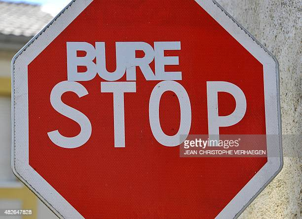 A road sign is tagged 'Bure Stop' on August 1 in Bure eastern France The 'VMC camp' will take place from August 1 to 10 to protest against the Cigeo...