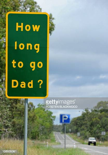 A road sign on the Bruce Highway south of Mackay asks the questions that children are likely to ask drivers to keep them awake on long stretches of...