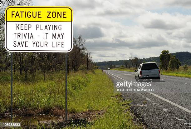 A road sign on the Bruce Highway south of Mackay on January 7 2011 warns drowsy drivers to play trivia to stay awake on long stretches of road AFP...