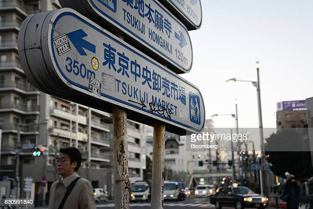 A road sign pointing to the Tsukiji Market stands in Tokyo Japan on Thursday Jan 5 2017 Kiyomura KK operator of Sushi Zanmai restaurant made the...