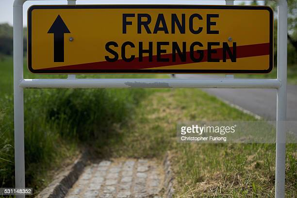 A road sign points the way to France as motorists leave the town of Schengen where the 1985 European Schengen Agreement was signed on May 11 2016 in...