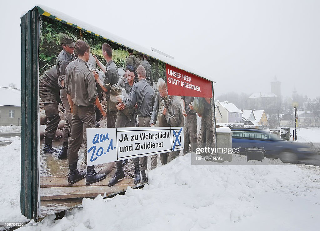 A road sign promoting the conscription of the Austrian Army is pictured in Allenstein, near Vienna, Austria on January 20, 2013. Opinion polls indicate that Austrians will decide Sunday in a referendum to remain one of the very few countries in Europe with compulsory military service. AFP PHOTO / DIETER NAGL