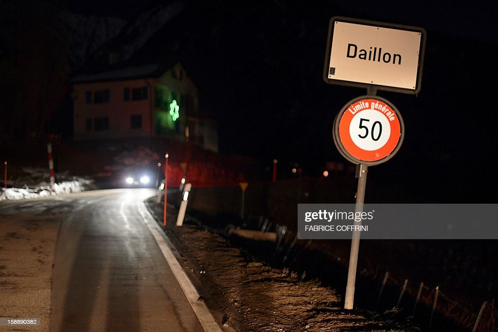 A road sign reading 'Daillon' is displayed on the side of a road leading into the village of Daillon early on January 3, 2013 after it was closed to the press. A gunman has opened fire in a village in southern Switzerland, killing three people and wounding two others, police said on January 3.