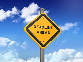 DEADLINE AHEAD Road Sign on Blue Sky and Clouds Background