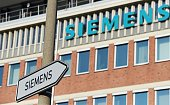A road sign shows the way to the entrance of the Siemens factory in Nuremberg southern Germany on March 10 2016 German engineering giant Siemens said...